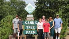 Group portrait of Kann family tree farmers